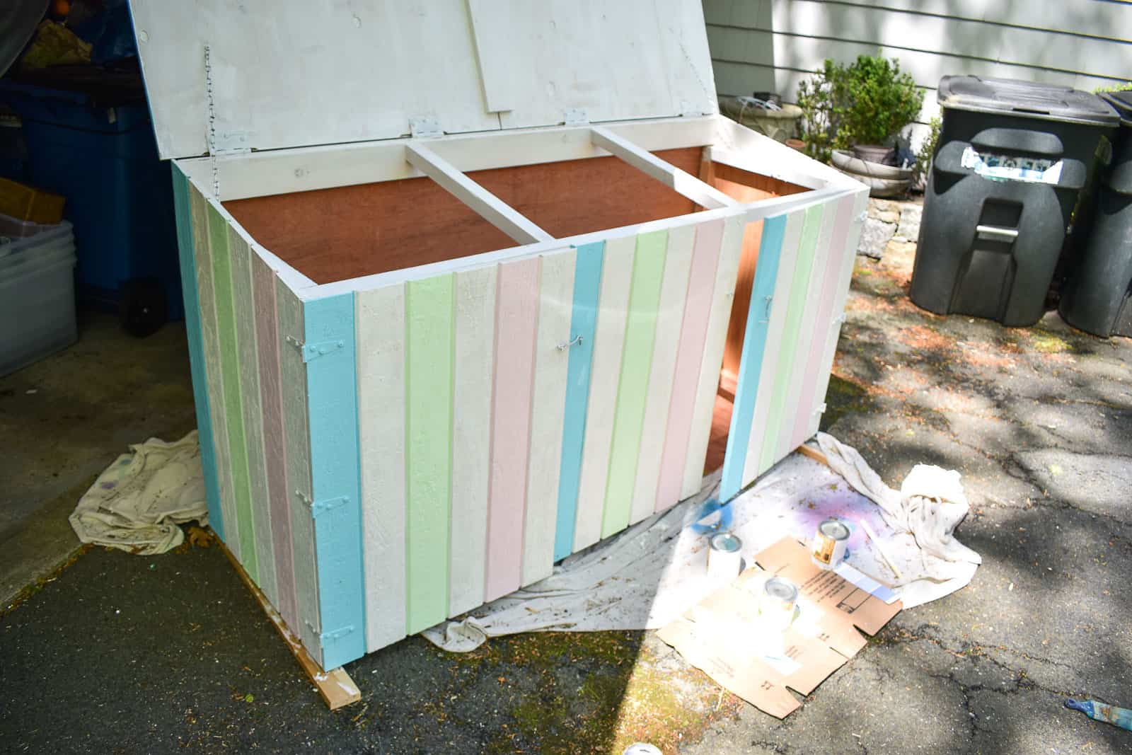painting stripes on trash can shed