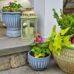 gray planters paired with green planter