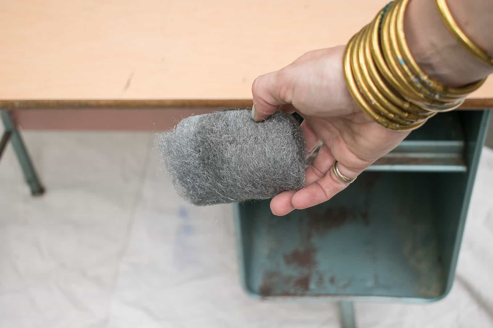 scrub the desk with steel wool