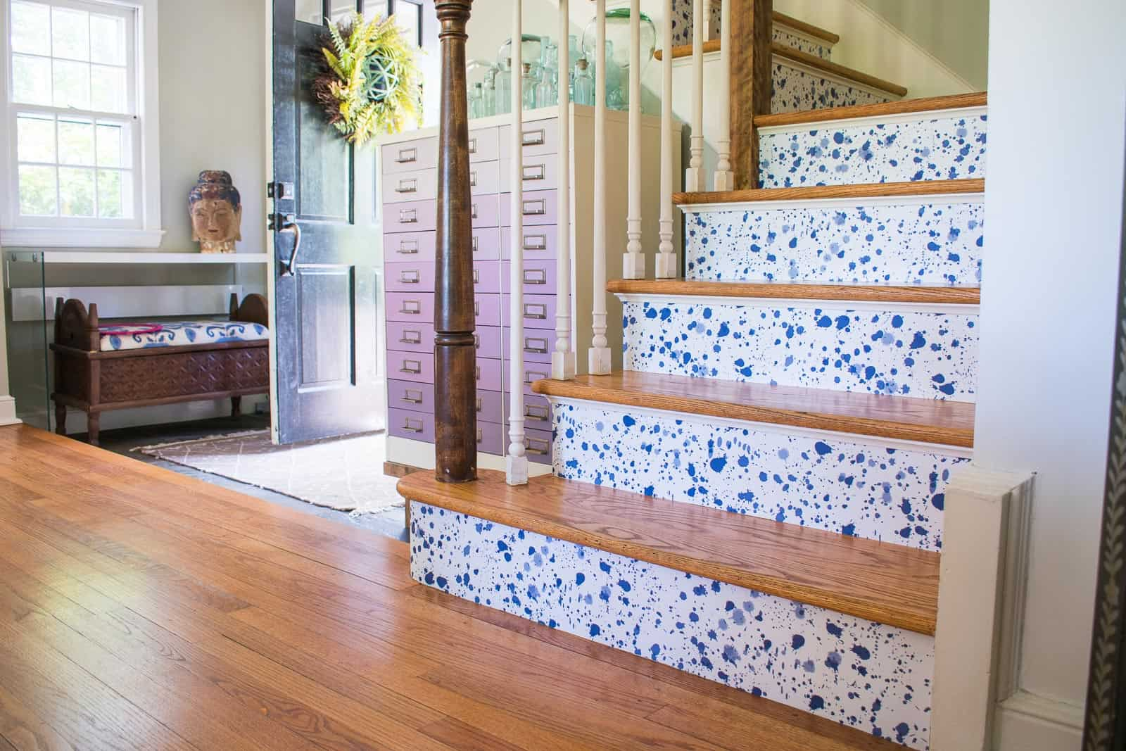 finished stair risers with wallpaper