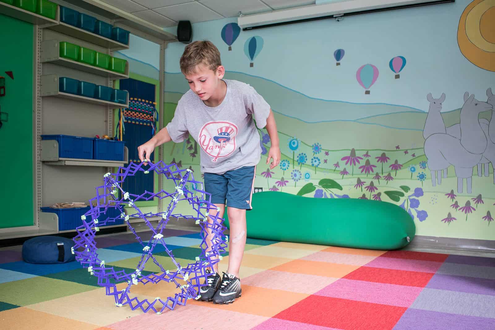 children enjoying a library maker space