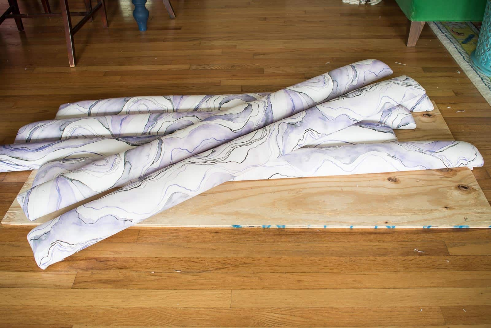 add upholstered strips to plywood