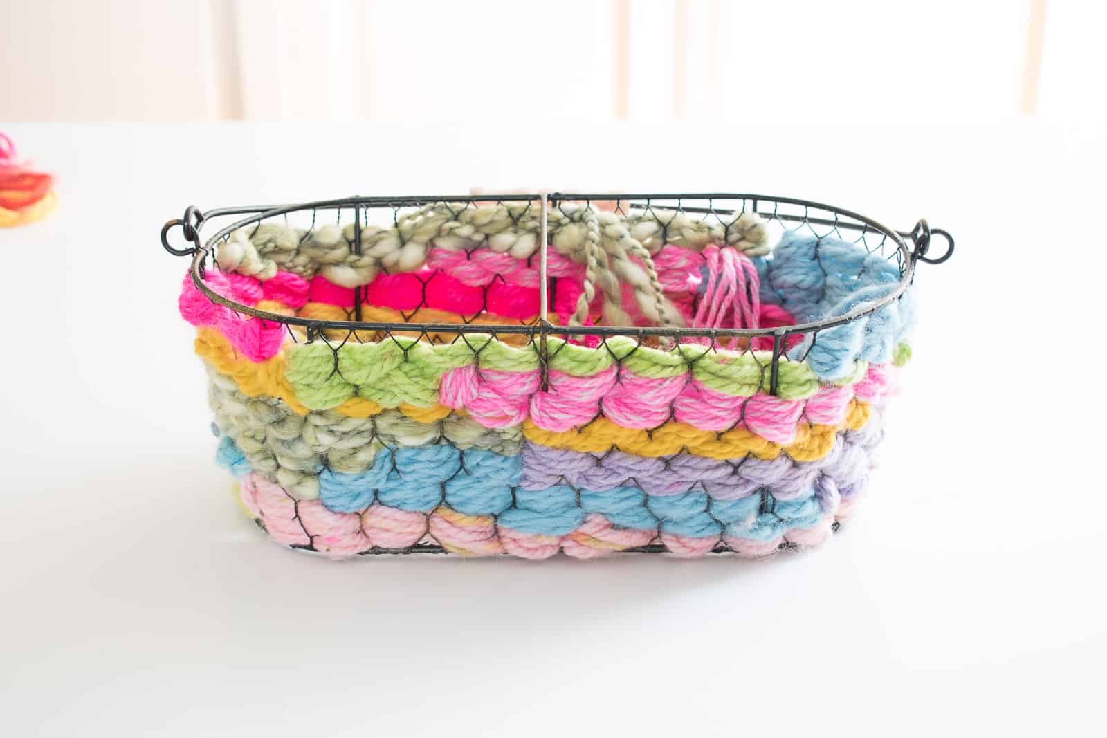 continue weaving the yarn around the basket