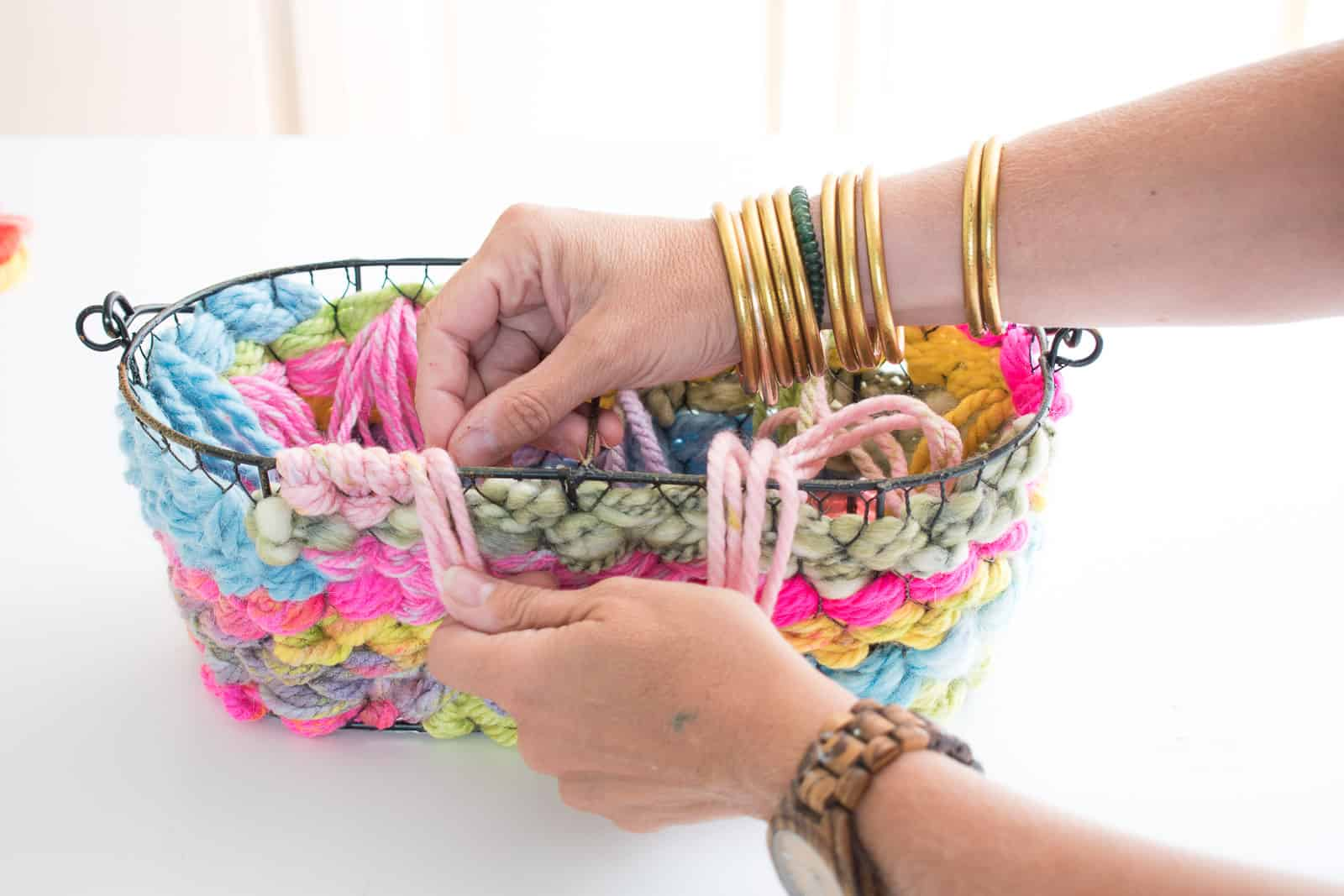 wrap the yarn around the top edge of the basket
