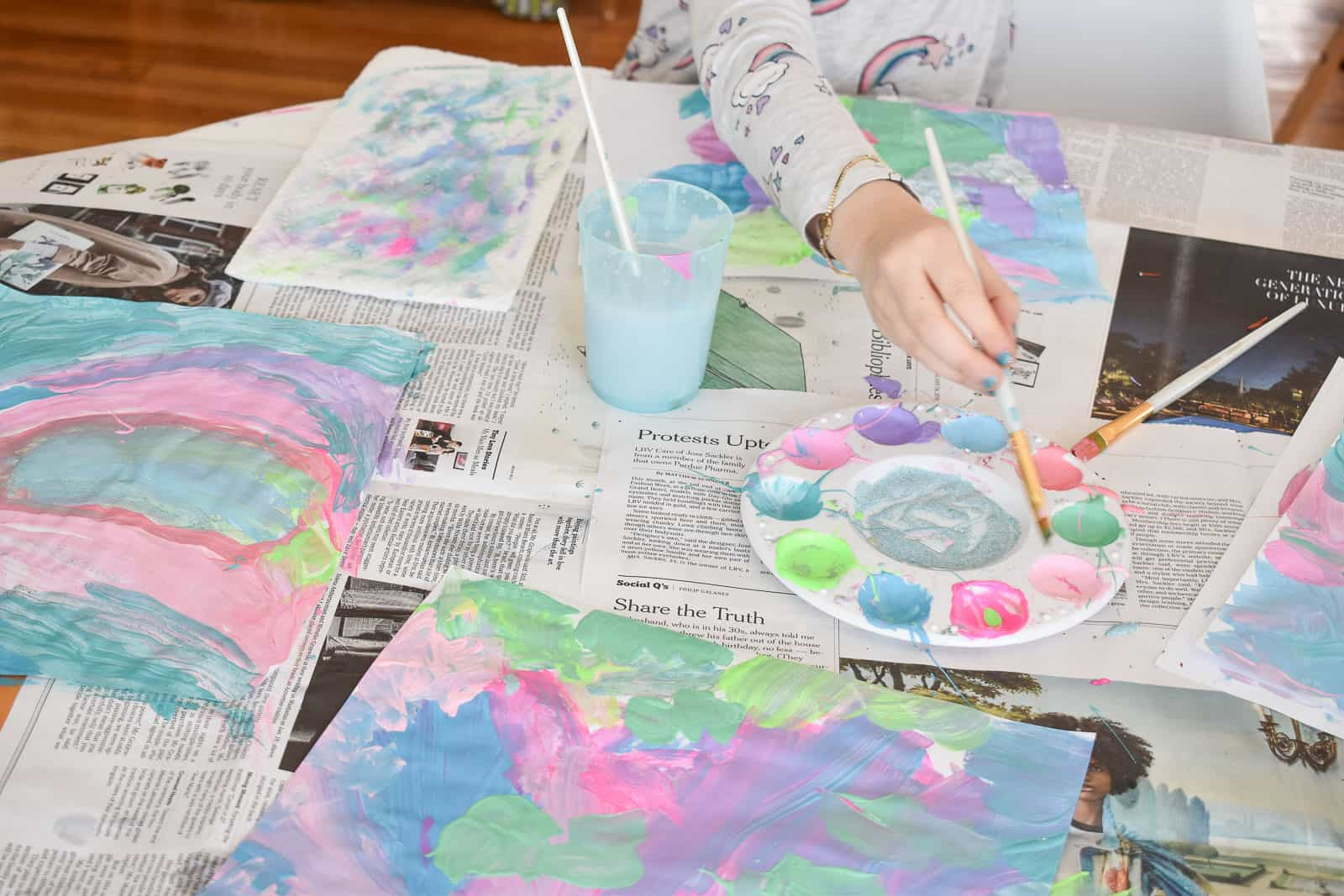 Kids painting with craft paint on paper