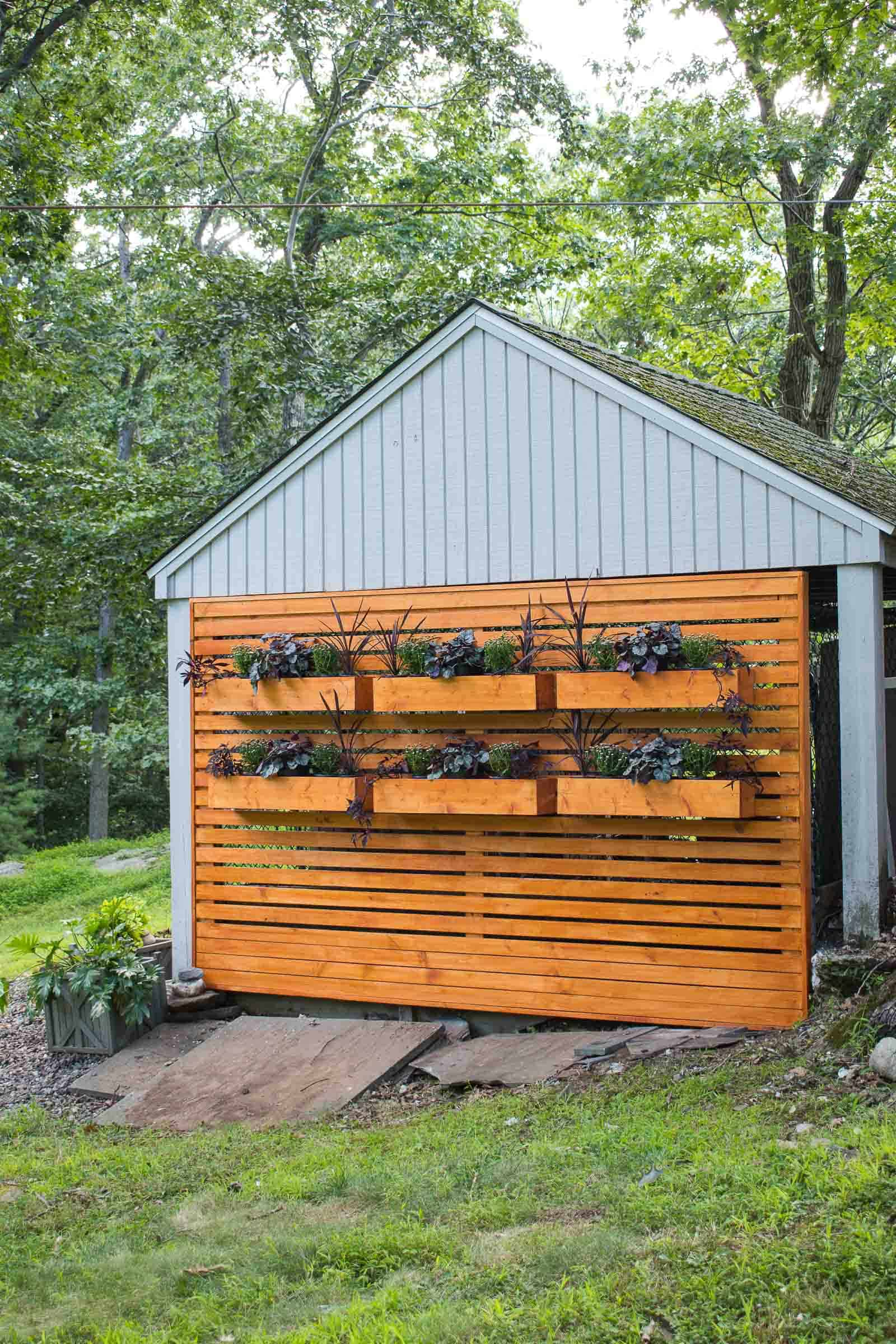 wooden privacy wall to hide a chain link fence