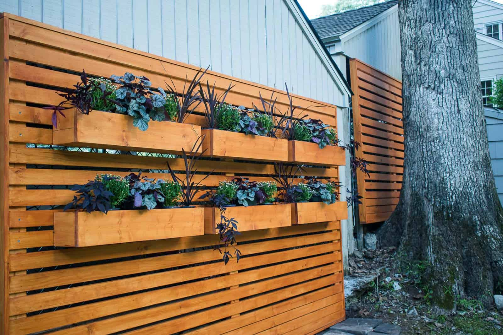 planters mounted on the wooden chain link fence cover