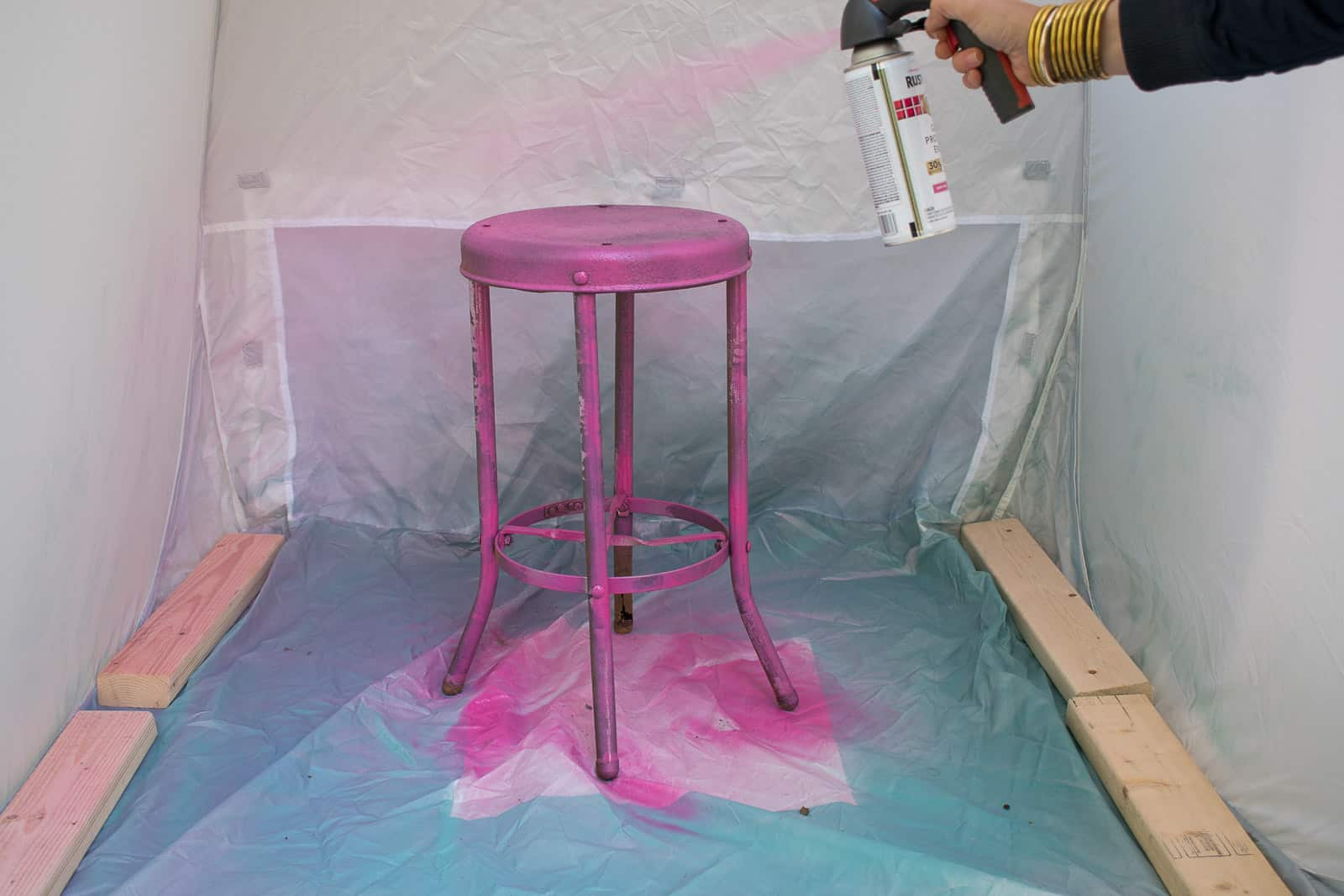 spray painting metal stool