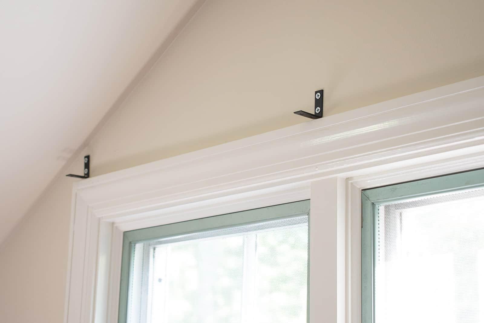 L brackets above window trim