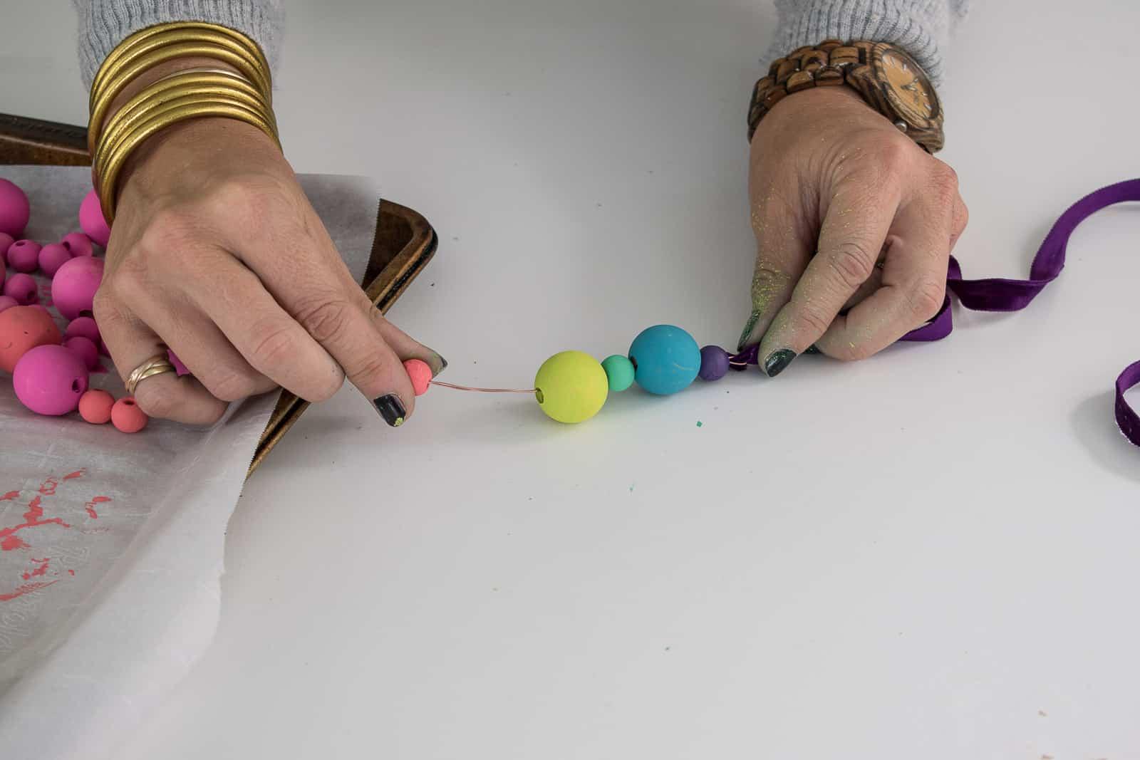 thread a ribbon through the beads