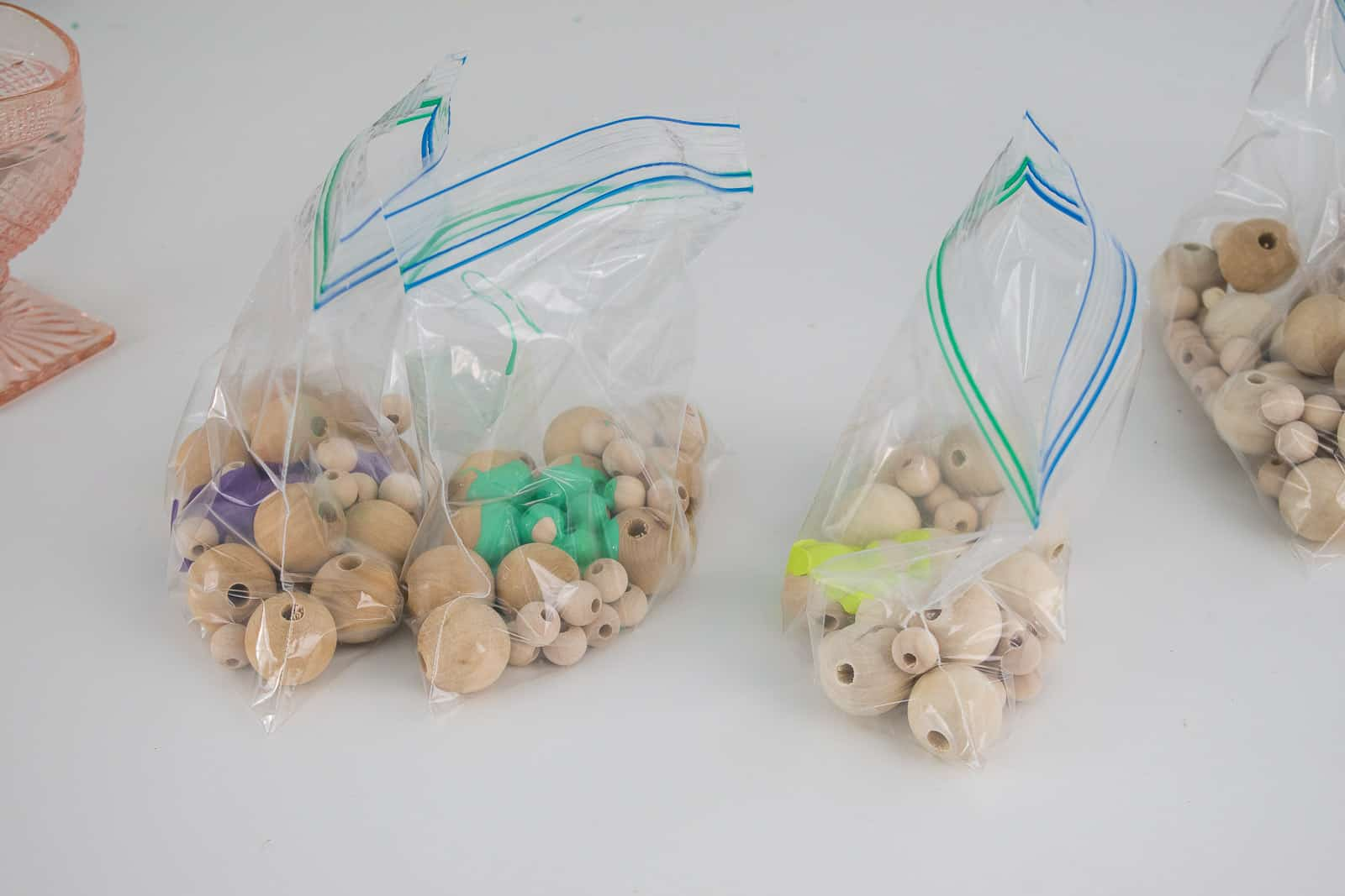 place beads and paint in plastic bag