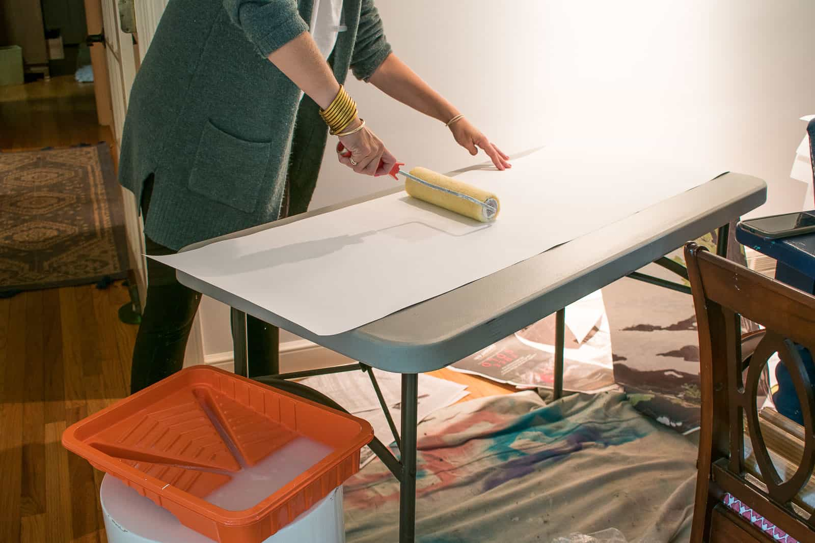roll starch onto wallpaper and hang