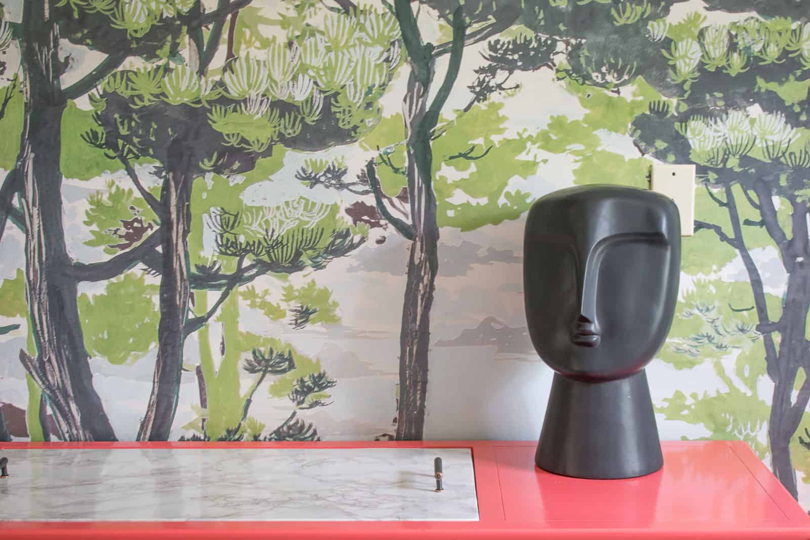 black figure in dining room
