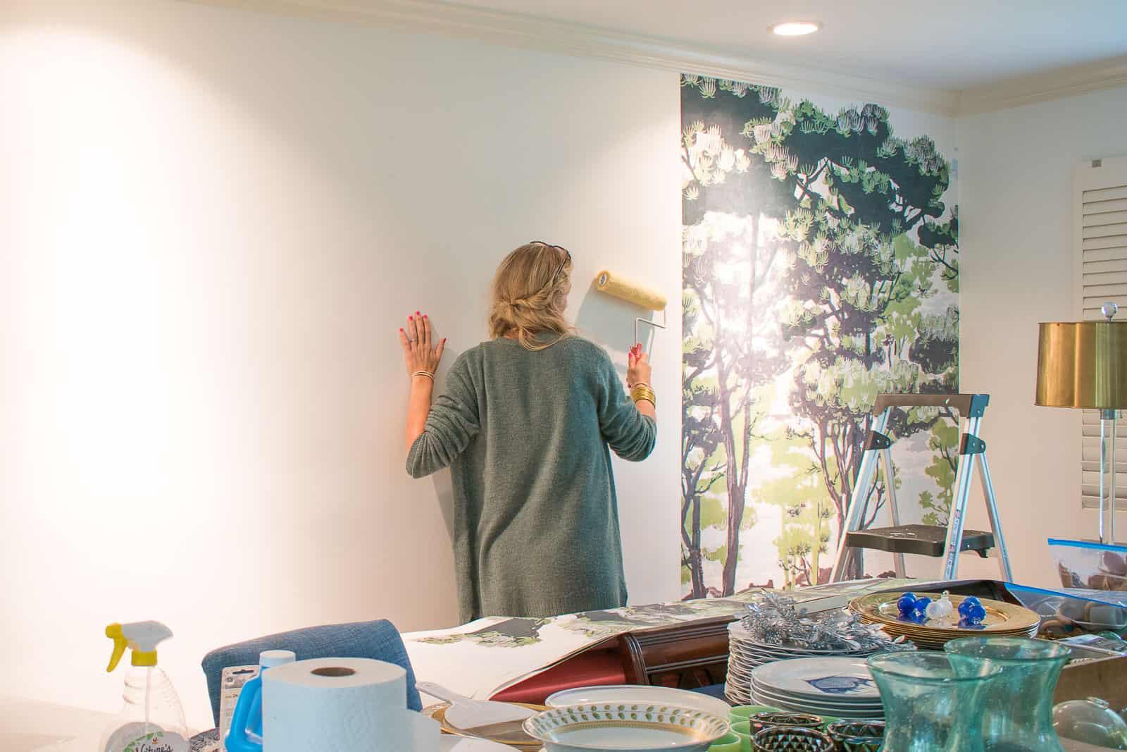 installing mural in dining room