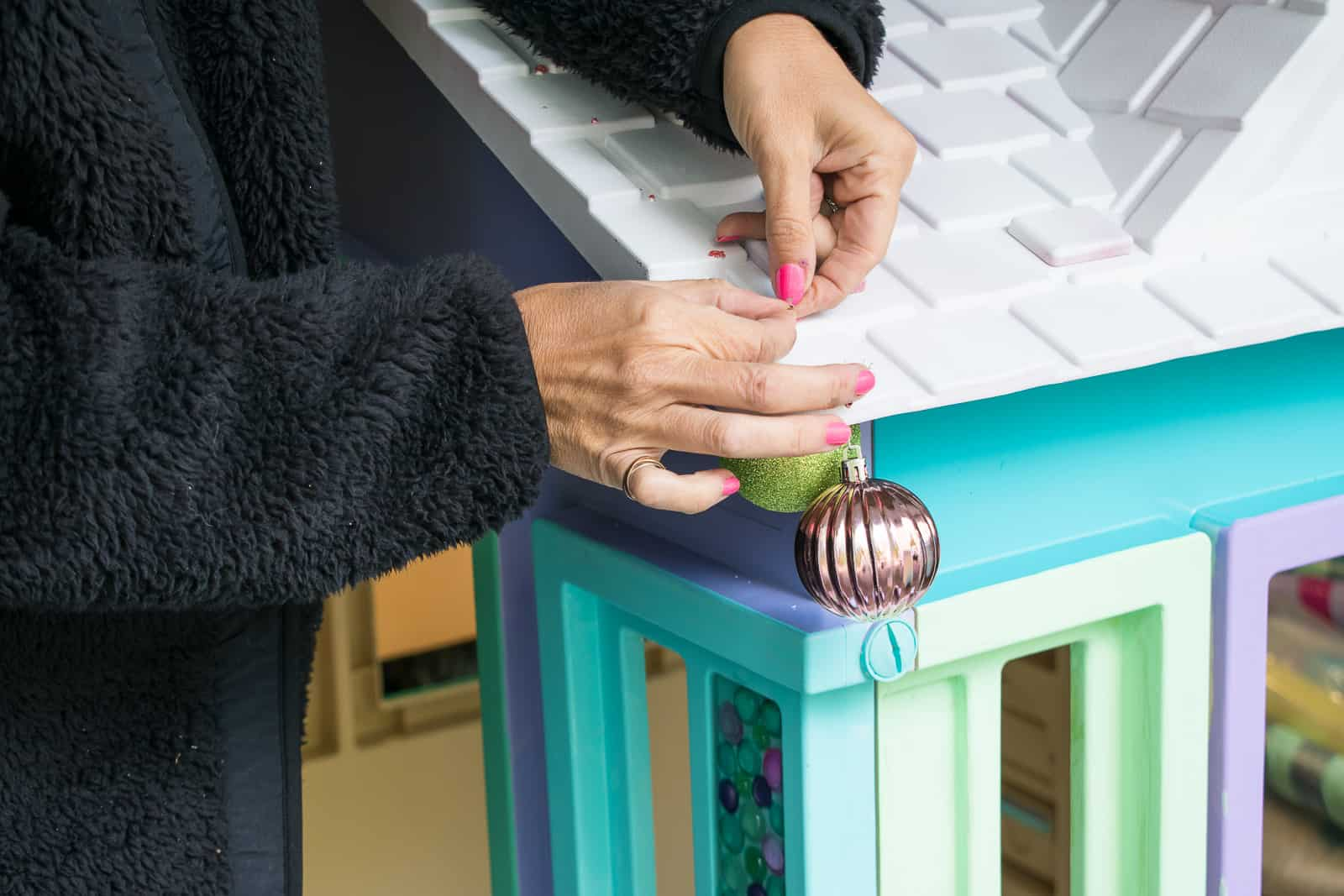drill holes and attach ornaments to eaves