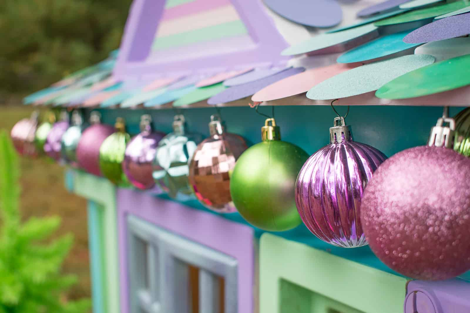 ornaments hanging from plastic house