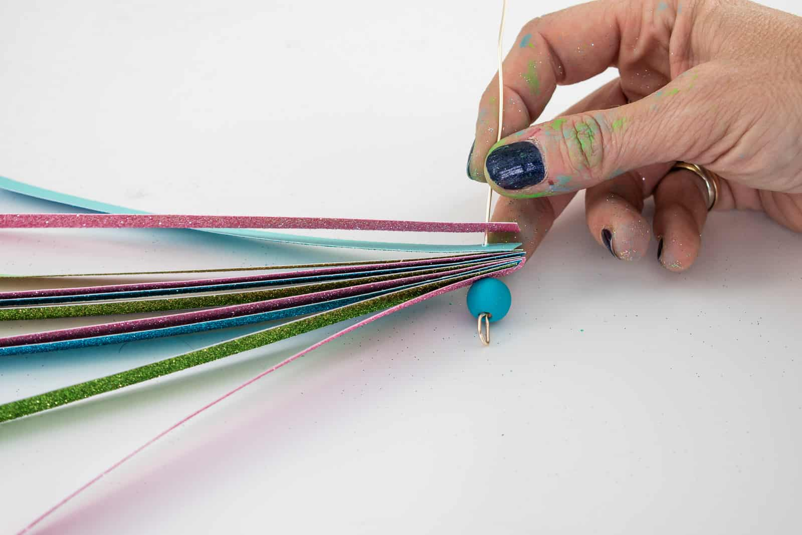 place paper strips onto the end of the floral wire