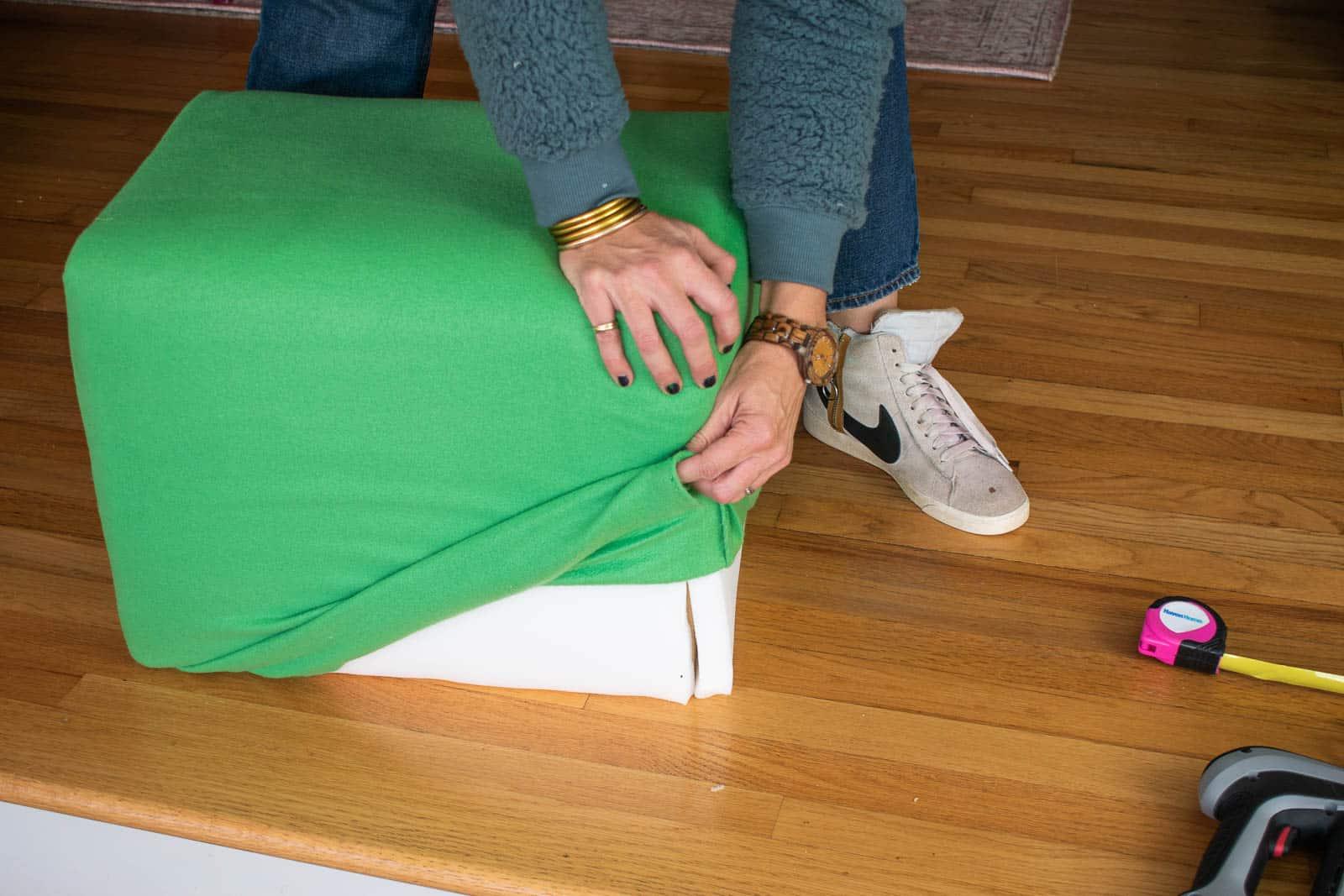 slip the slipcover onto ottoman
