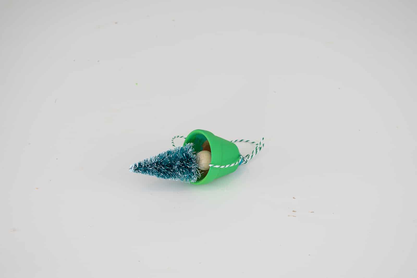 glue bottle brush tree onto beads