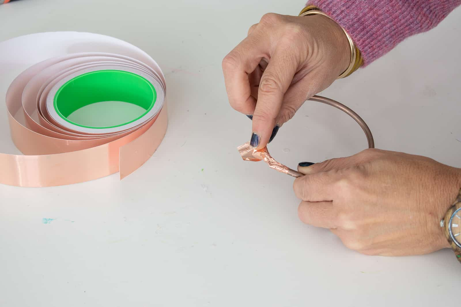 tape the ends of the copper circle together