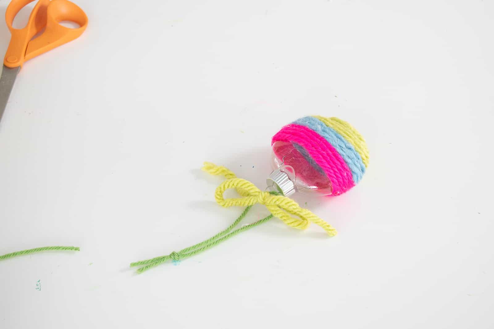 add yarn bow and hang