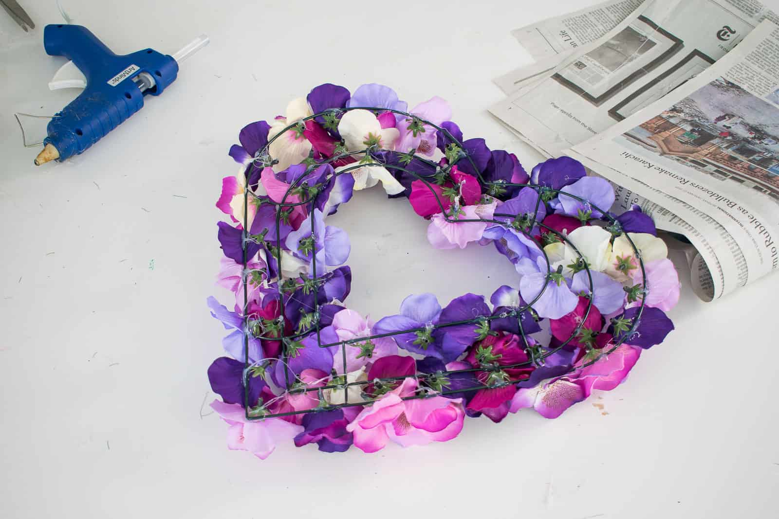 add flowers to wreath