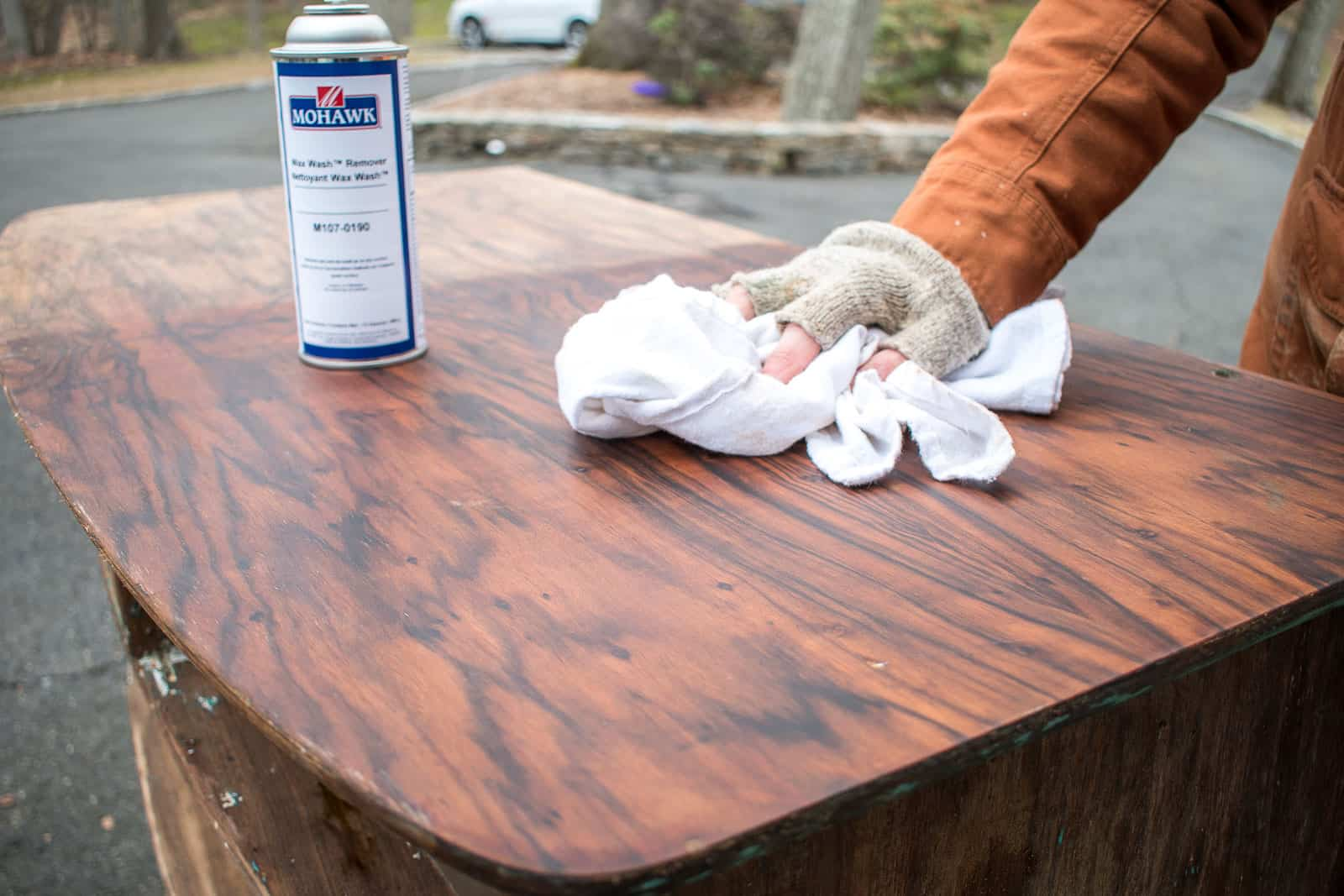 cleaning the wood with wax wash remover