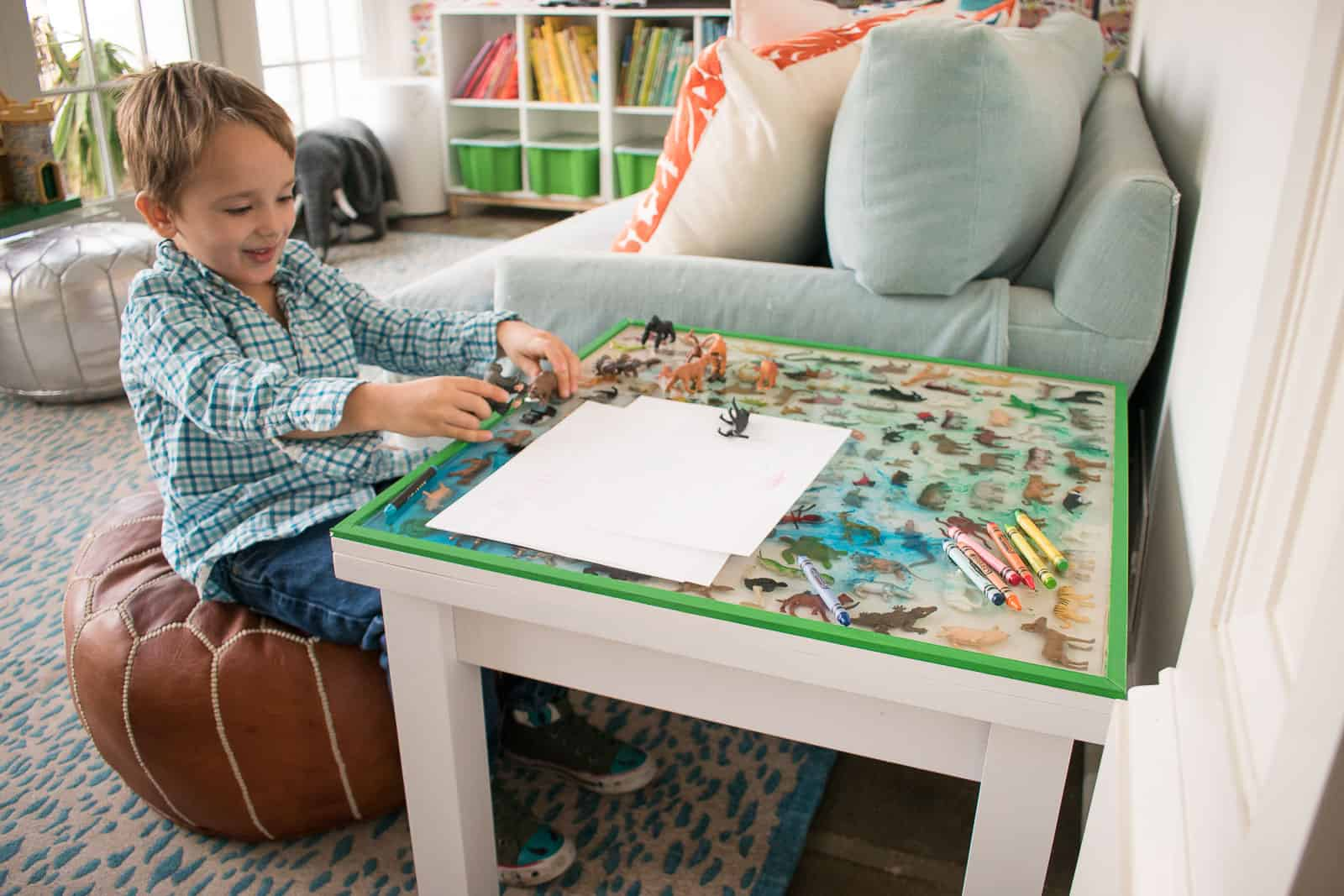 arthur playing at epoxy table