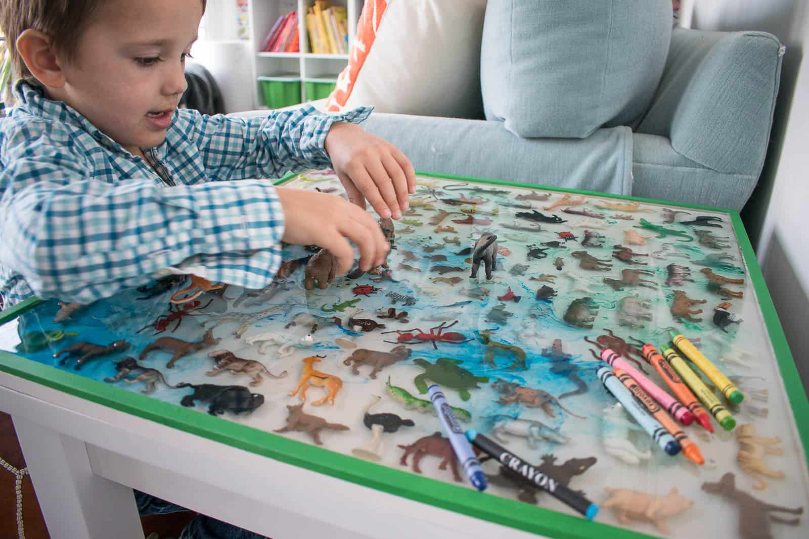 boy playing at epoxy table