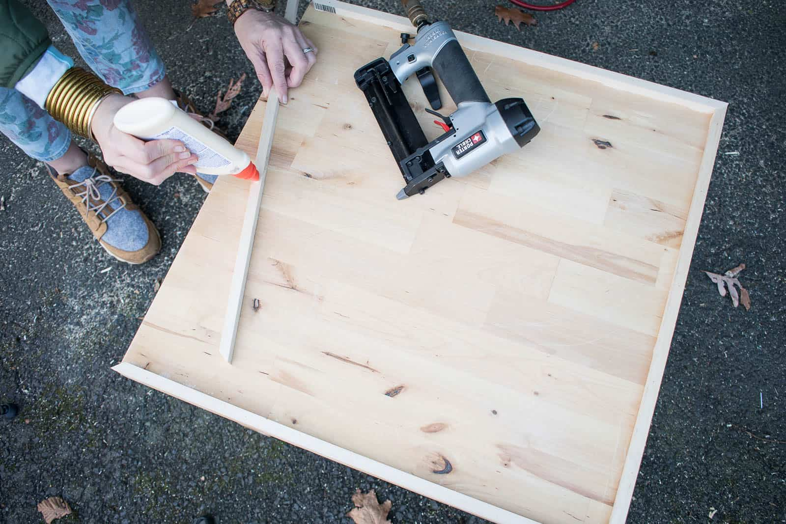 glue and nail trim onto sides of table