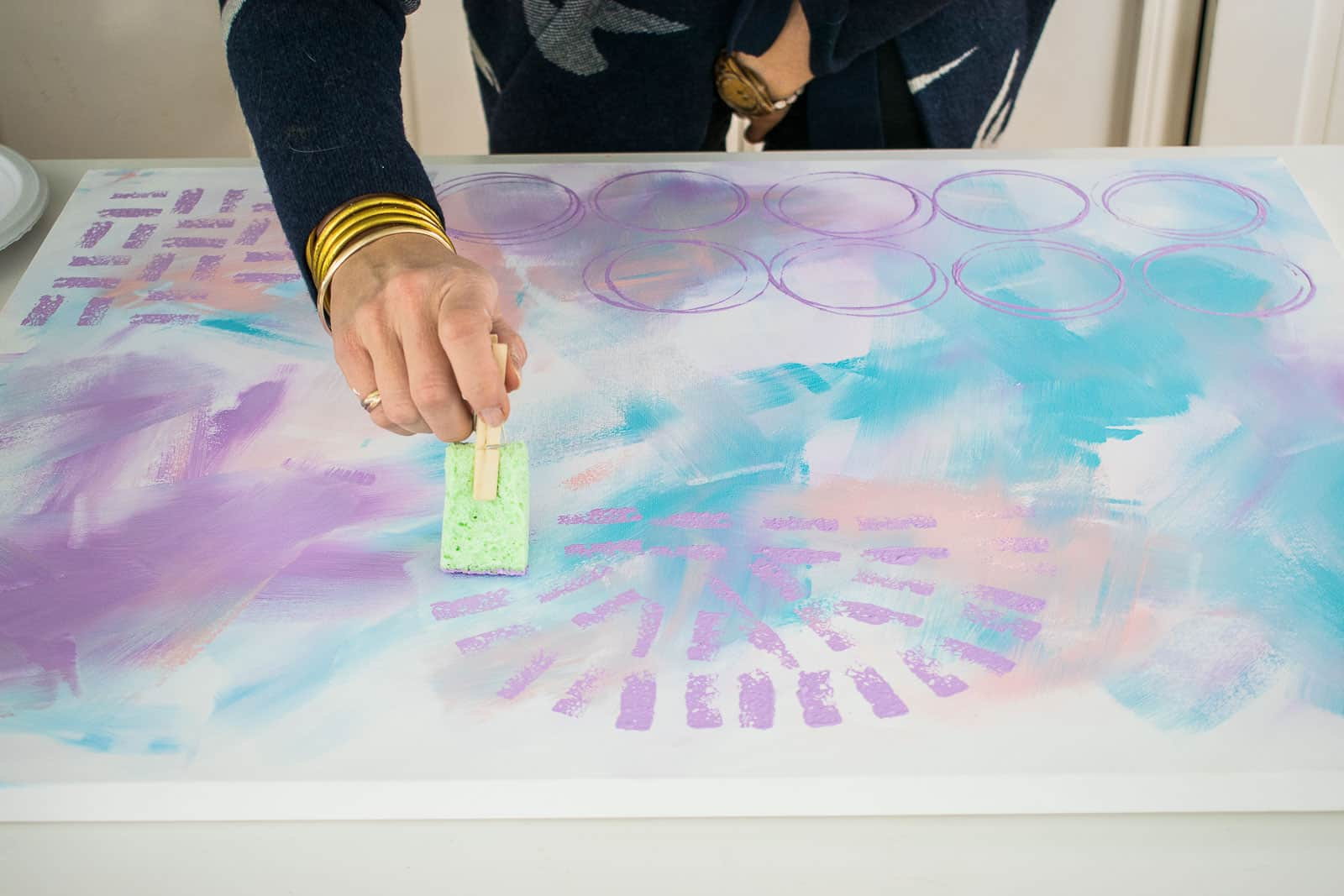 using a sponge to add pattern to canvas