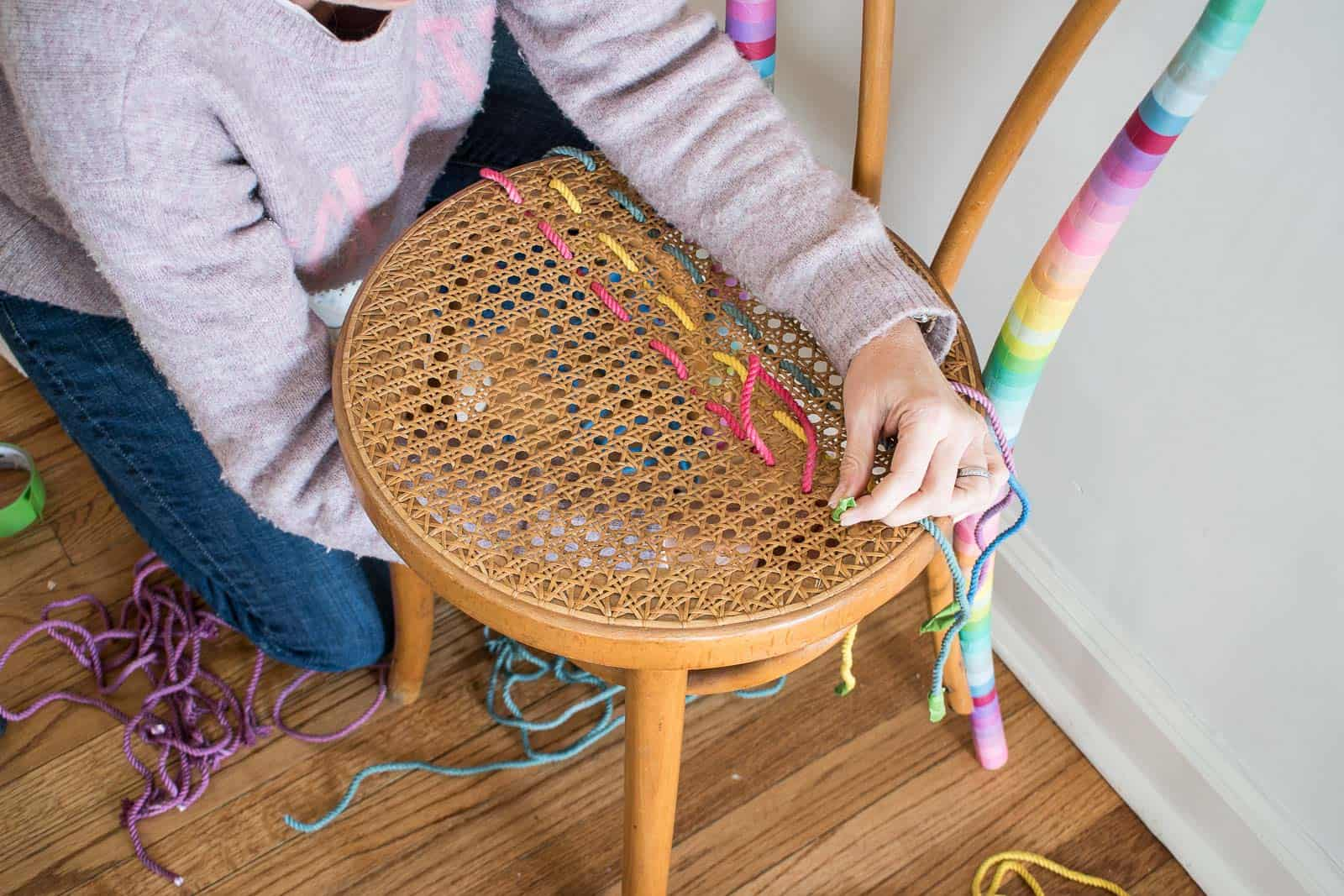 weaving rope through the cane seat