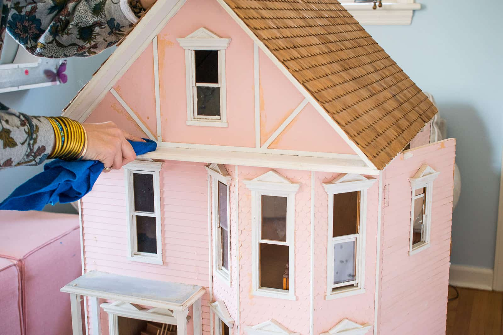 cleaning the dollhouse exterior