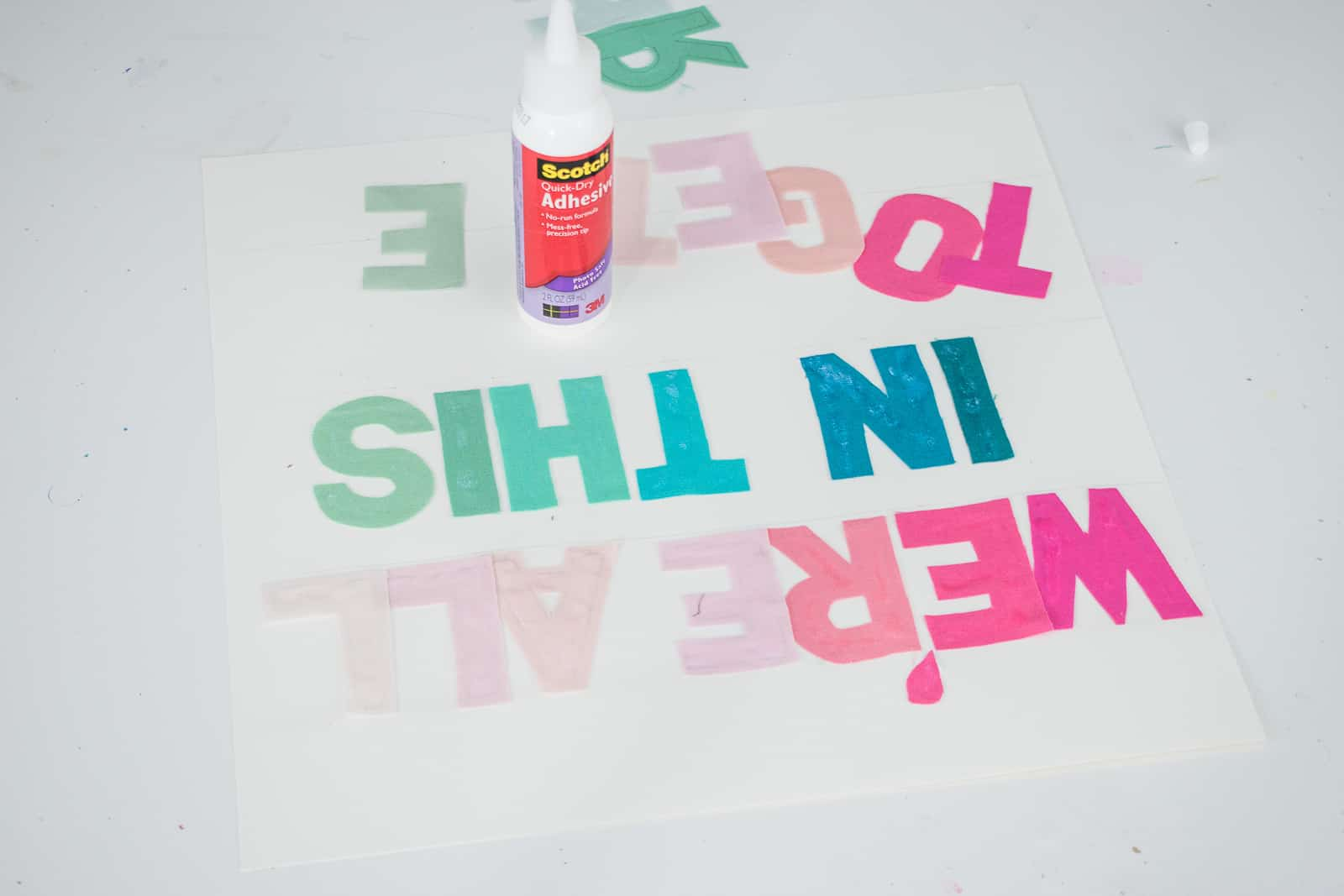 glue fabric letters onto paper