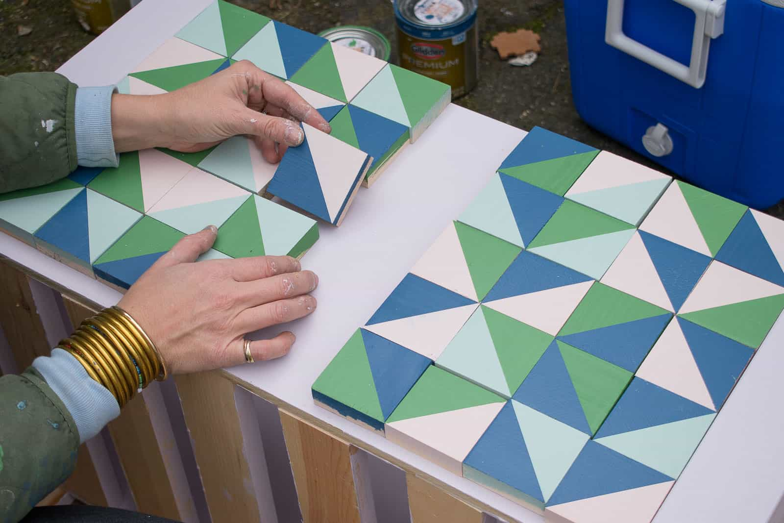 arranging the squares onto the wood box