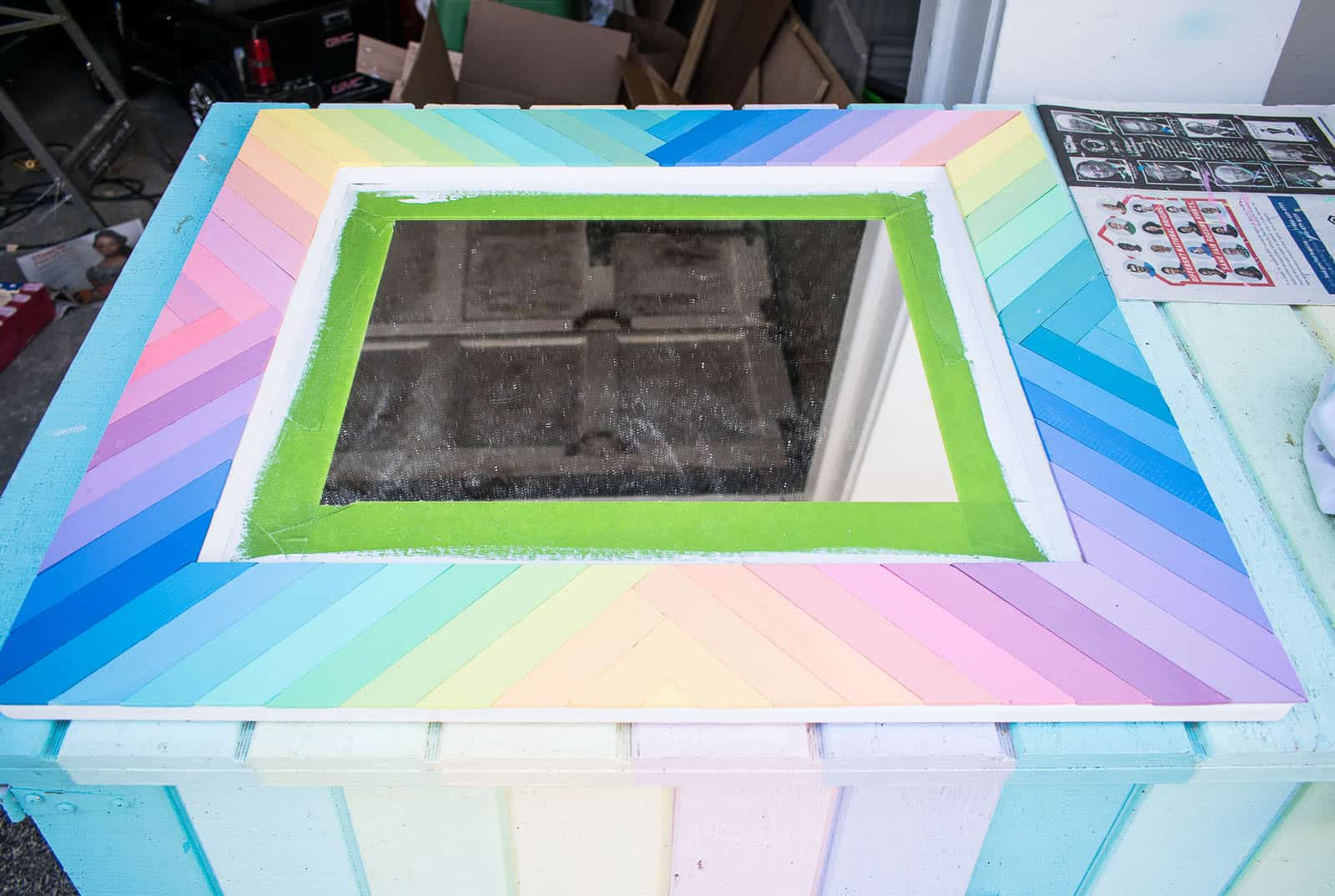paint stirrers glued to the mirror