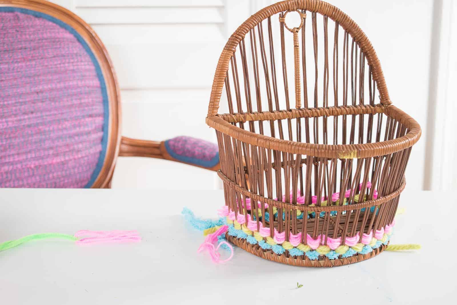 weaving yarn through a basket
