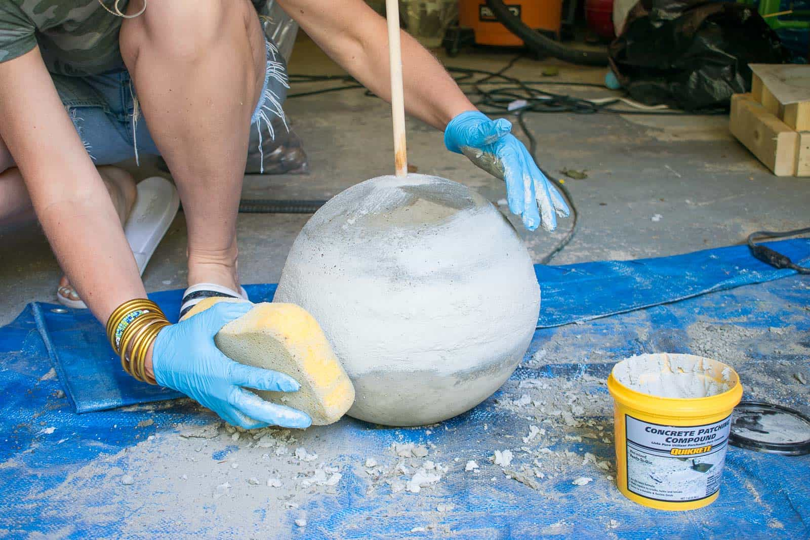 use a wet sponge to smooth out concrete