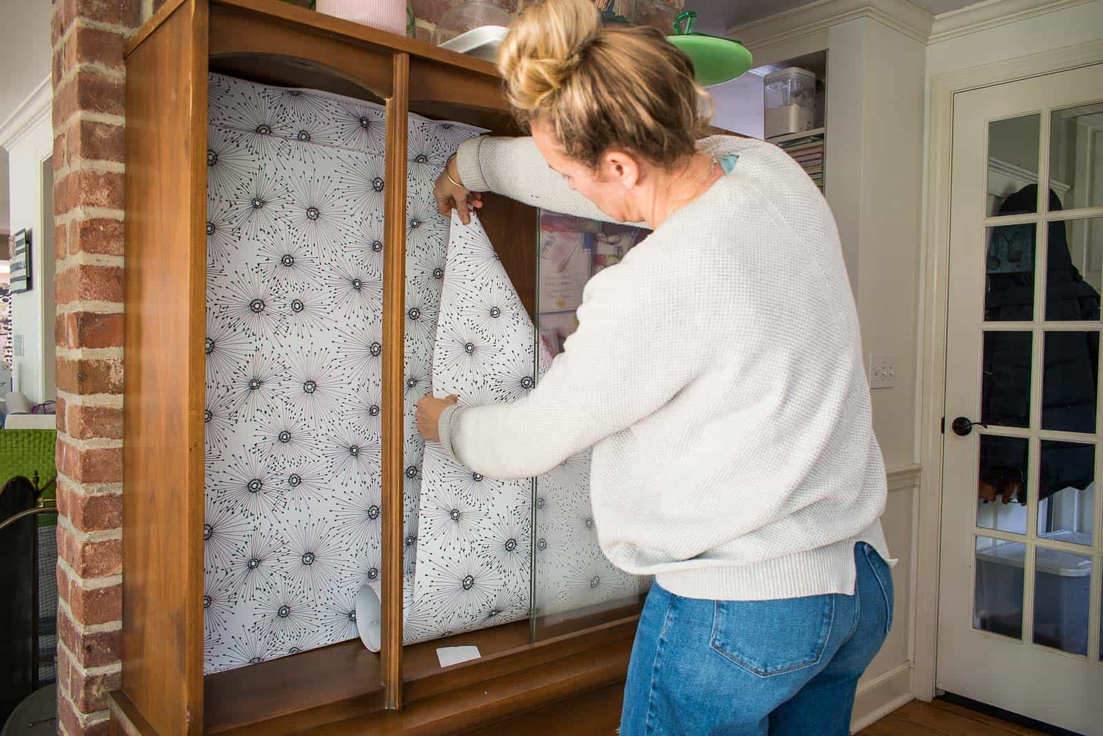 apply wallpaper to back of furniture