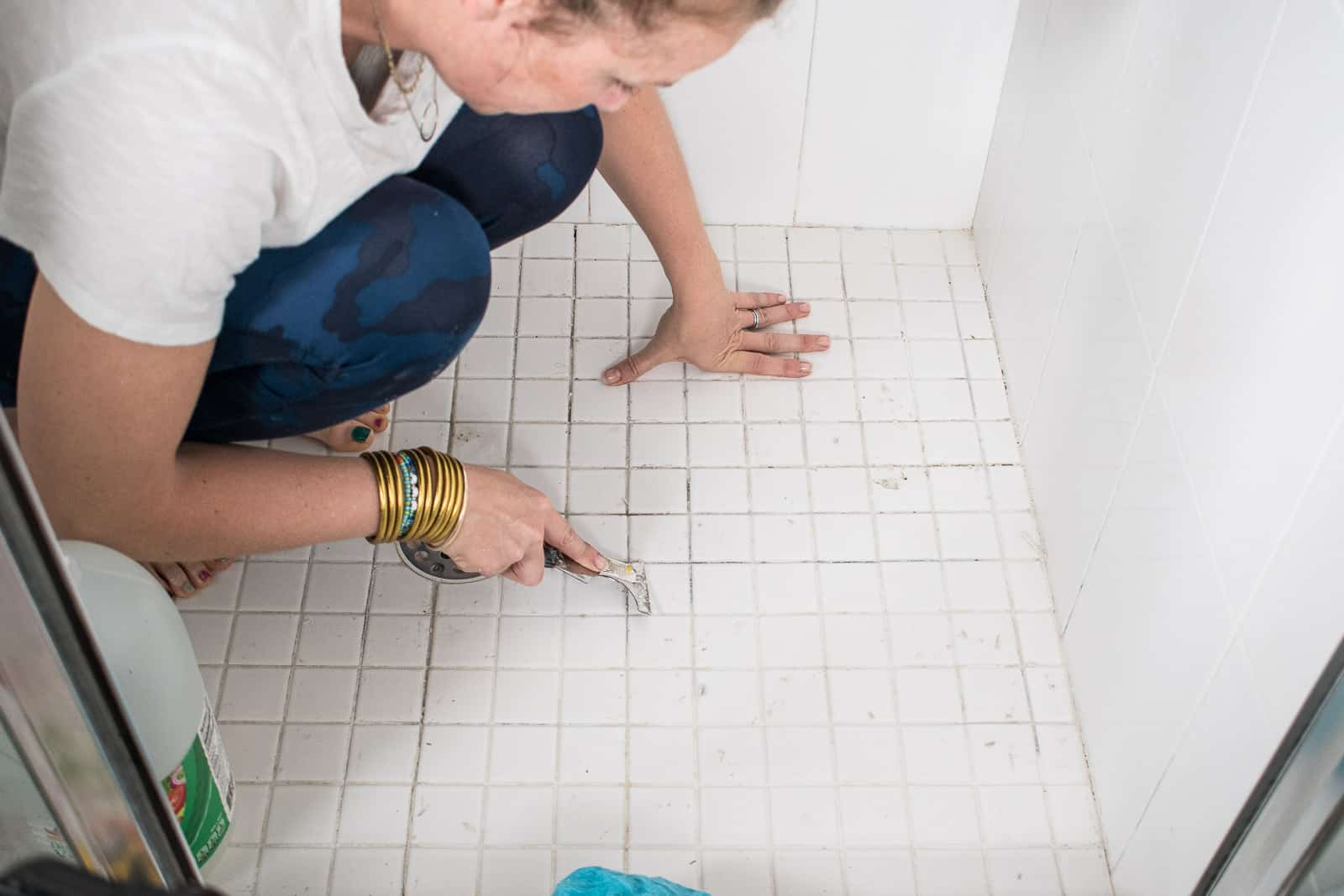 scraping away grout