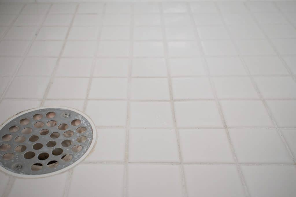 replacing cracked grout in shower