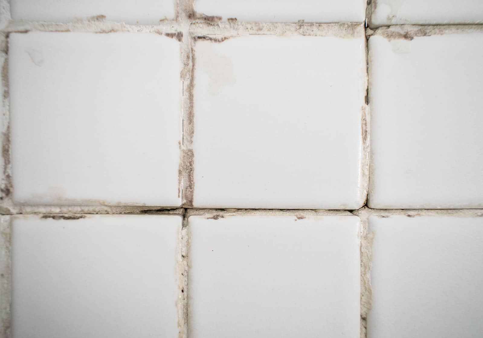 cracked grout between the tiles