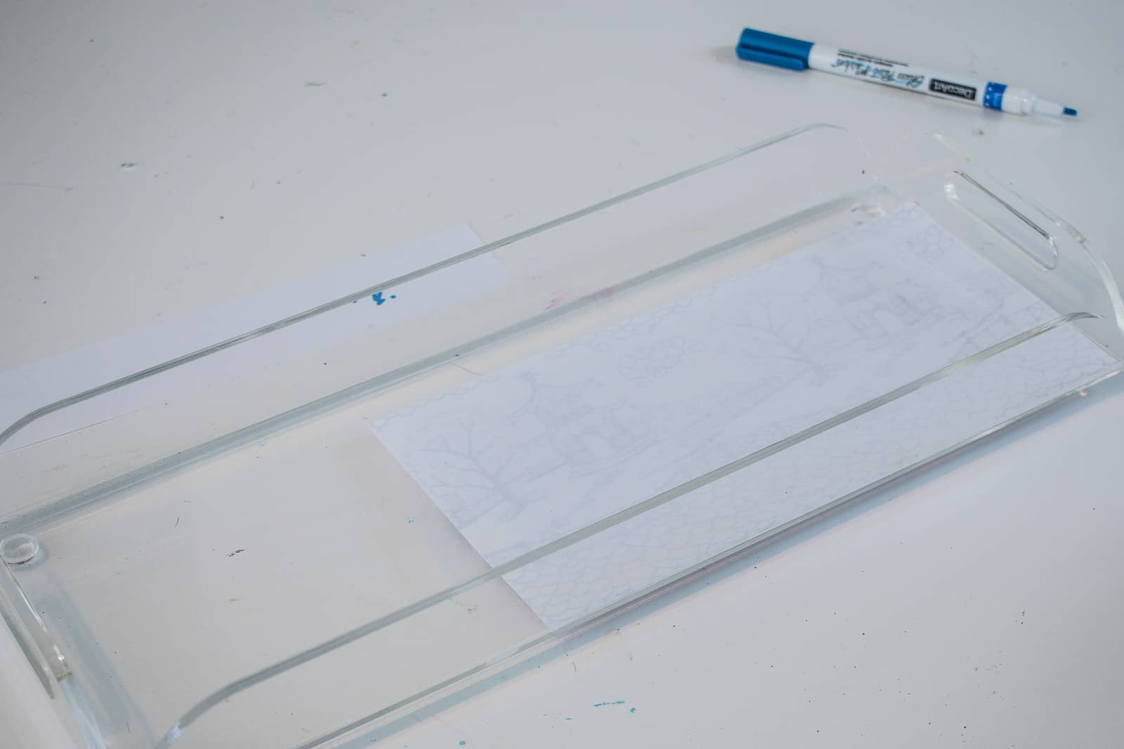 tape the pattern to the tray
