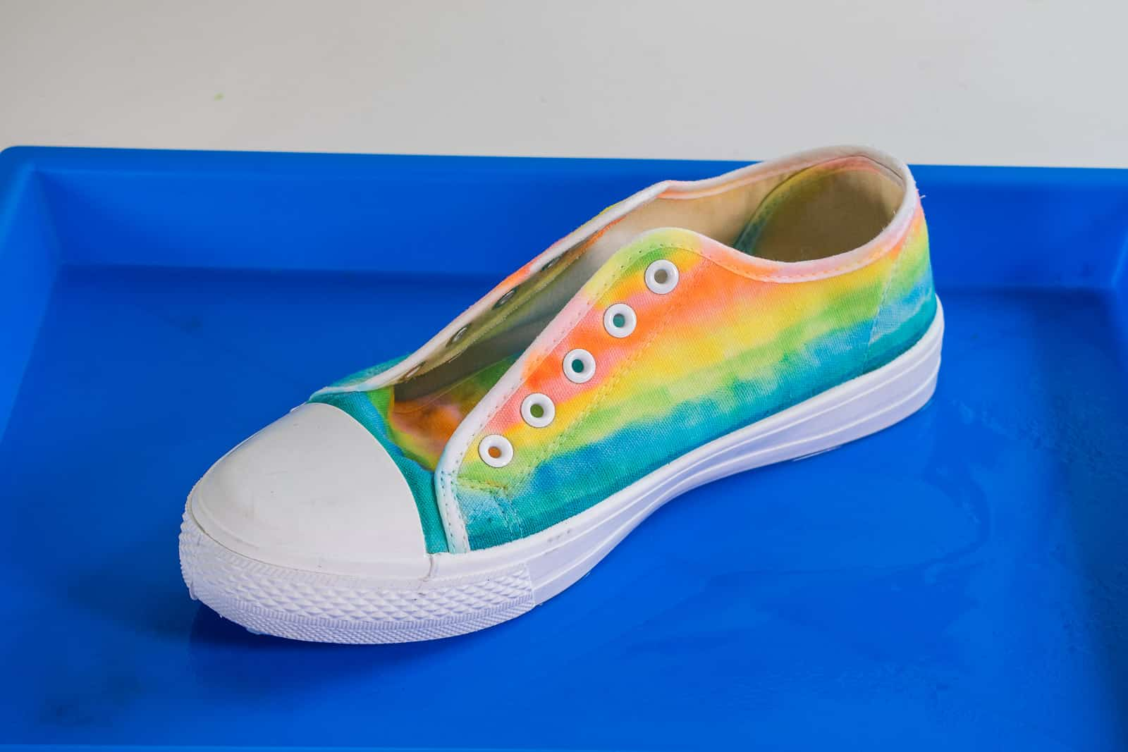 spray shoes with rubbing alcohol