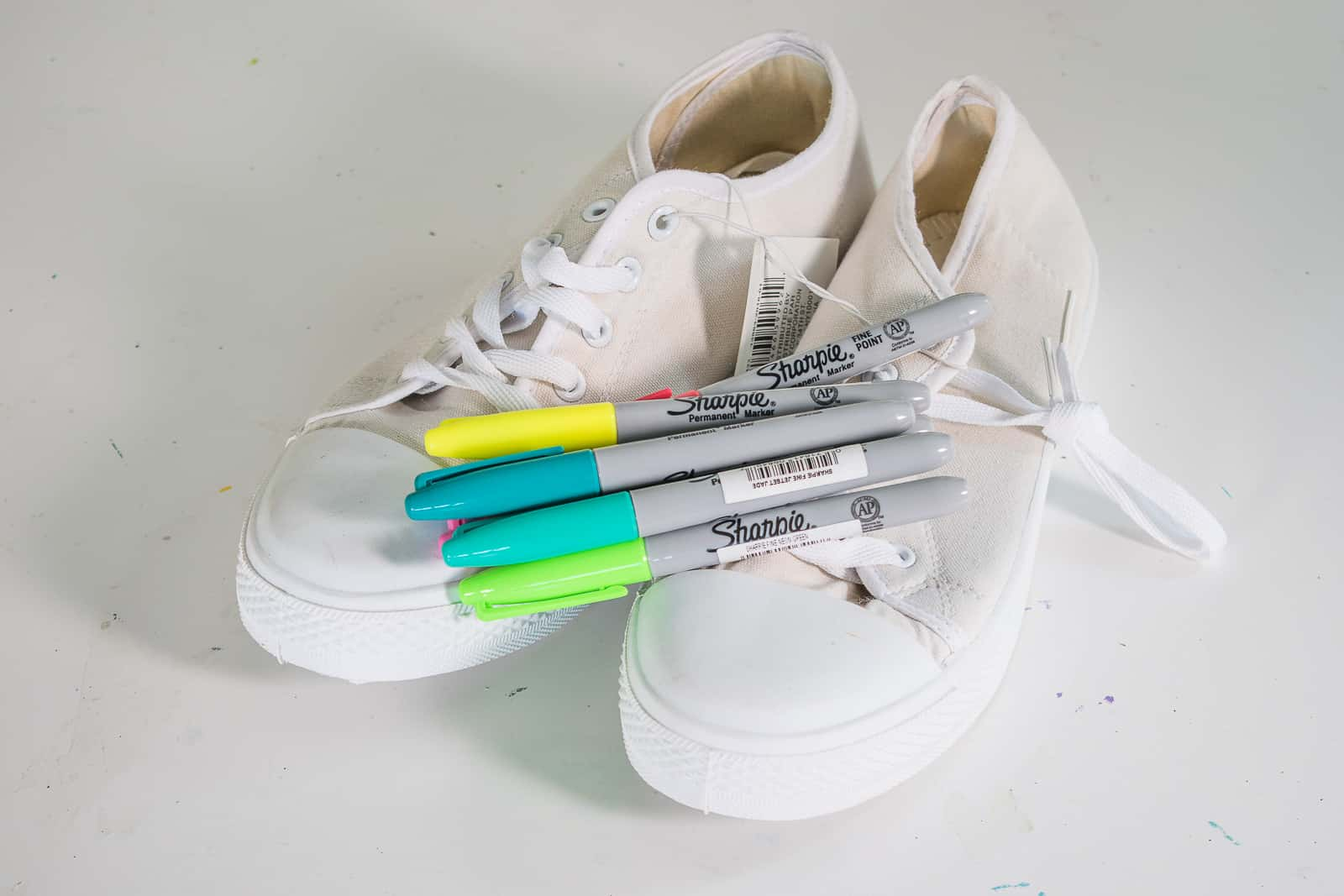 canvas shoes and sharpie markers