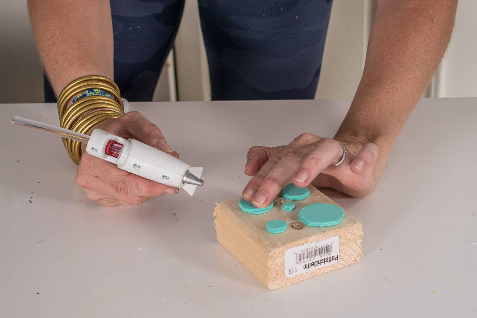 hot glue foam onto scrap wood