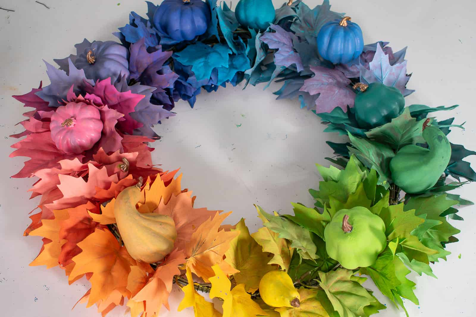 attach painted gourds to wreath