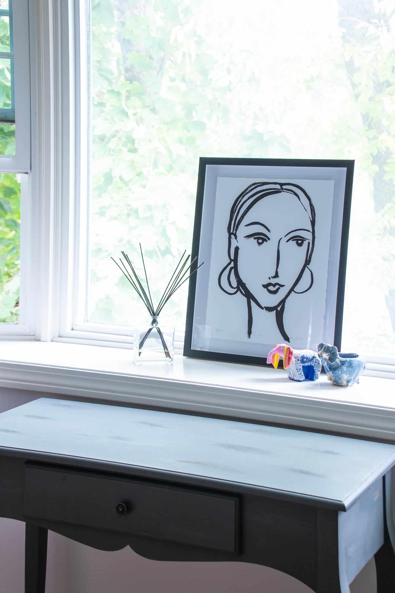 woman's painting in repainted bedroom
