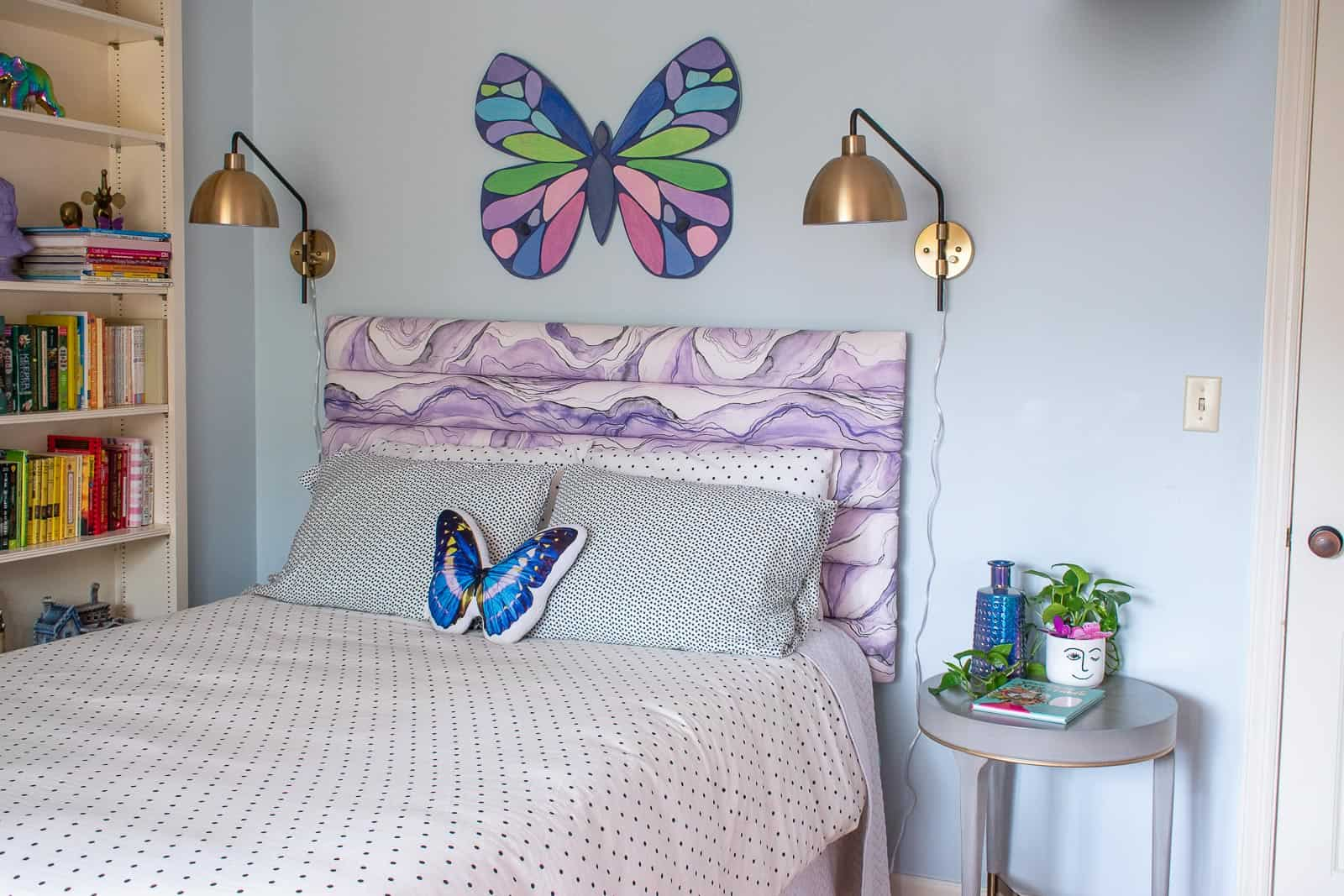 sconces over bed in girls room