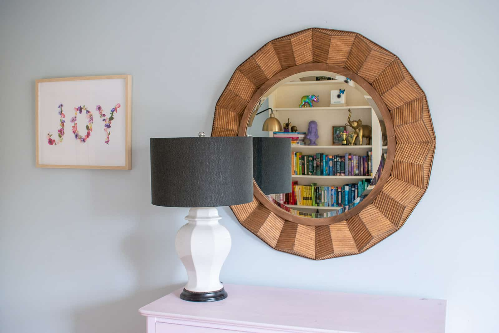 large rattan mirror in girls room